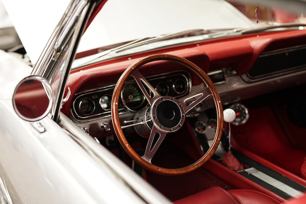 High angle closeup shot of a white retro car with a beautiful steering wheel Free Photo