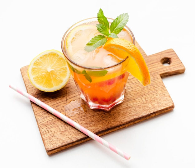 High angle cocktail with orange on cutting board and copy-space Free Photo