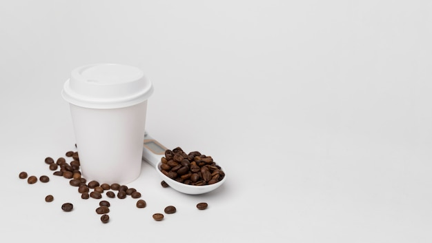 High angle coffee beans and cup Free Photo
