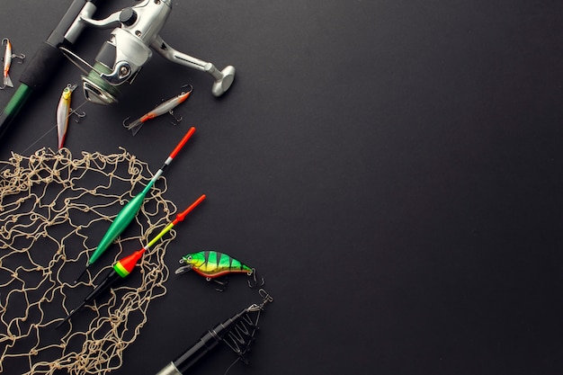 High angle of colorful fishing bait with net and copy space Free Photo