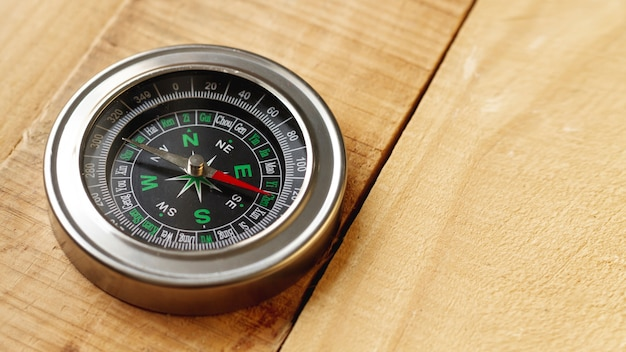 High angle compass on wooden board with copy-space Free Photo