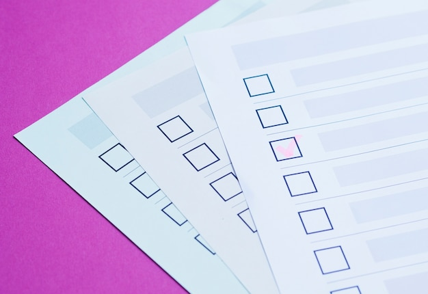 High angle completed election questionnaire close-up Free Photo