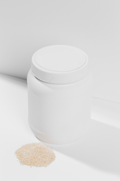High angle container with gym powder supplements Free Photo