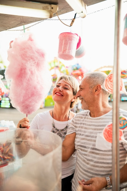 High angle couple with pink cotton candy Free Photo