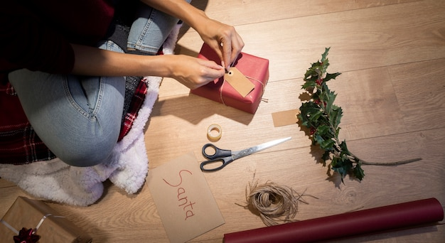 High angle crafting time to wrap gifts Free Photo