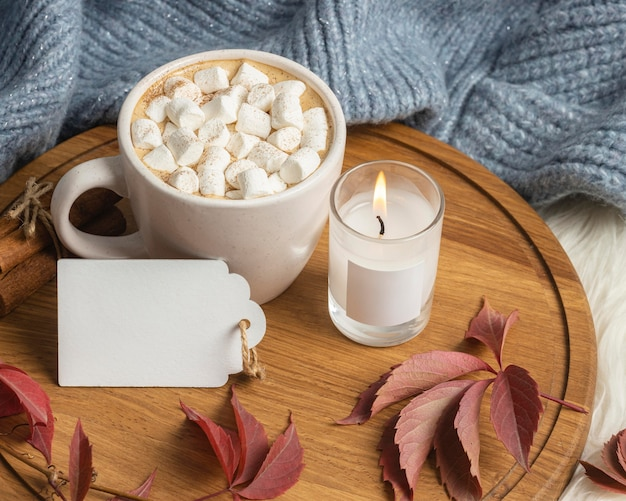 High angle of cup of hot cocoa with marshmallows and candle Free Photo
