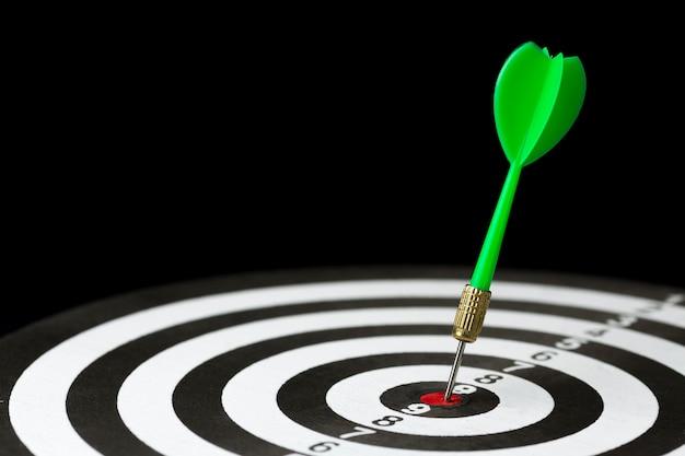 High angle of dart stuck in target bullseye Free Photo