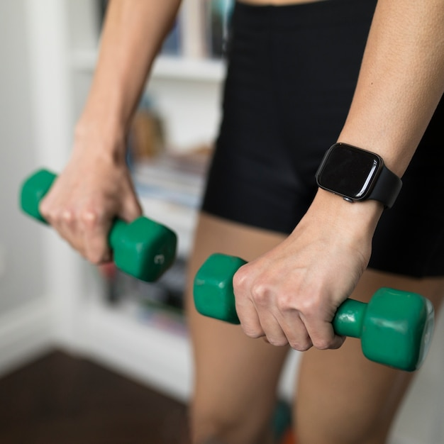 High angle of defocused woman using weights Free Photo