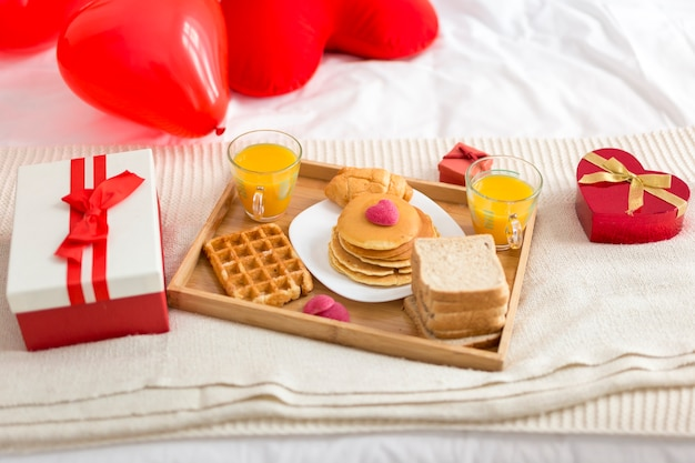High angle delicious breakfast in bed Free Photo