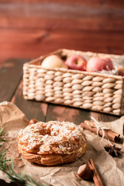 High angle of doughnut with basked of apples Free Photo