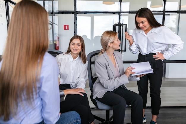 High angle females strategizing at work Free Photo