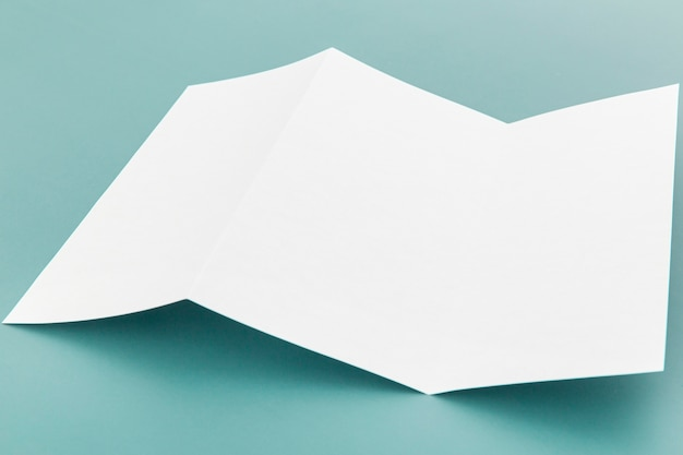 High angle folded white brochure Free Photo