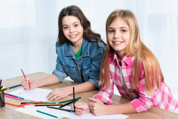 High angle girls coloring Free Photo