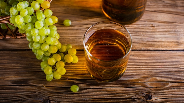 High angle glass with natural grapes bunches Free Photo