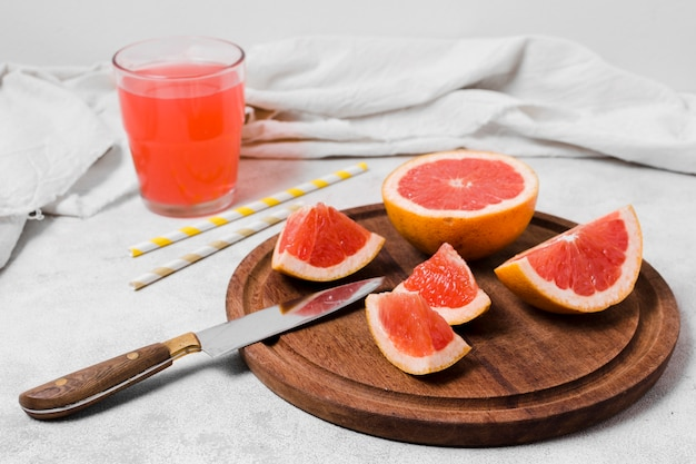 High angle of grapefruit slices with juice Free Photo