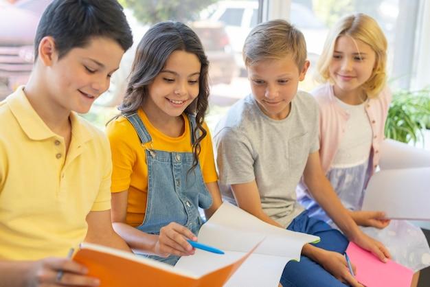 High angle group of kids reading Premium Photo