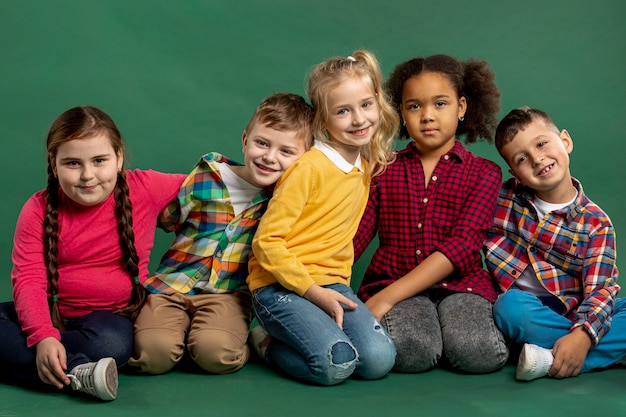 High angle group of smiley childrens Free Photo