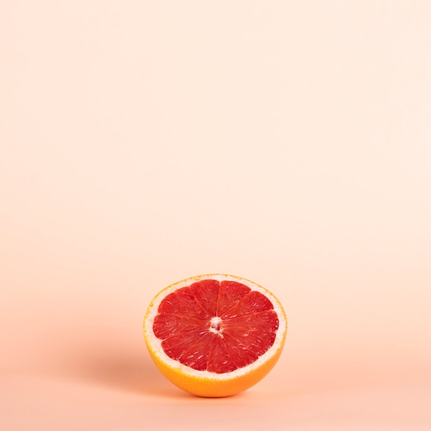 High angle half red orange with copy-space Free Photo