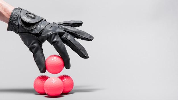 High angle hand arranging golf balls Free Photo