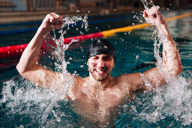 High angle happy male swimmer of victory Free Photo