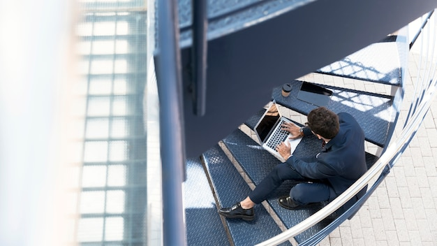 High angle lawyer working on the stairs Free Photo