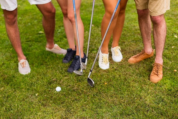 High angle legs of golfers with clubs Free Photo