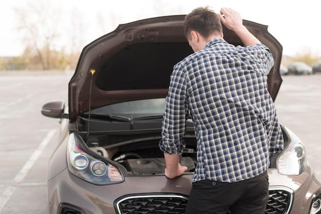 High angle man checking car Premium Photo