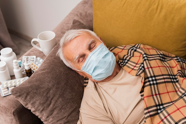 High angle man sleeping with mask Free Photo