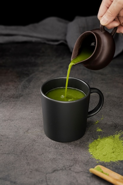 High angle of matcha tea poured in cup Free Photo