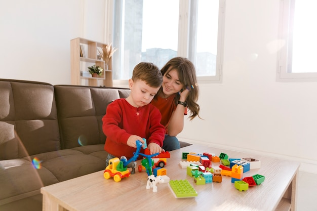 High angle mom and son playing with toys Free Photo