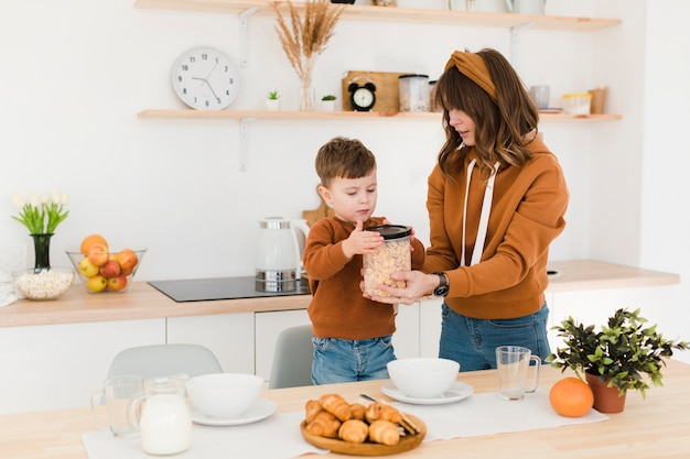 High angle mother and son in kitchen Free Photo