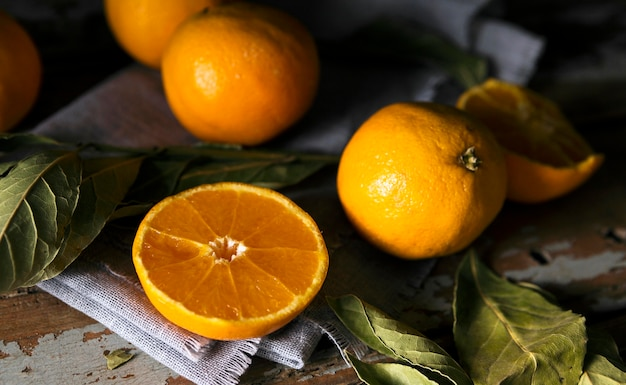 High angle of multiple autumn oranges with leaves Premium Photo