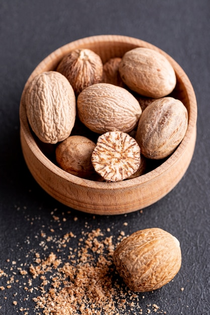 High angle of nutmeg in bowl Premium Photo