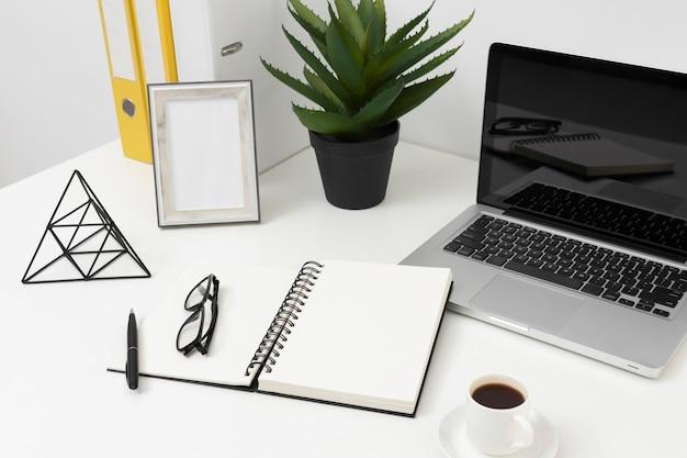 High angle office desk arrangement Free Photo