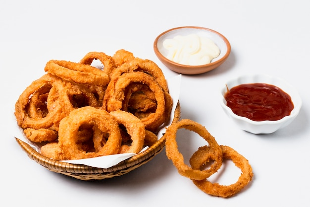 High angle of onion rings with ketchup Free Photo