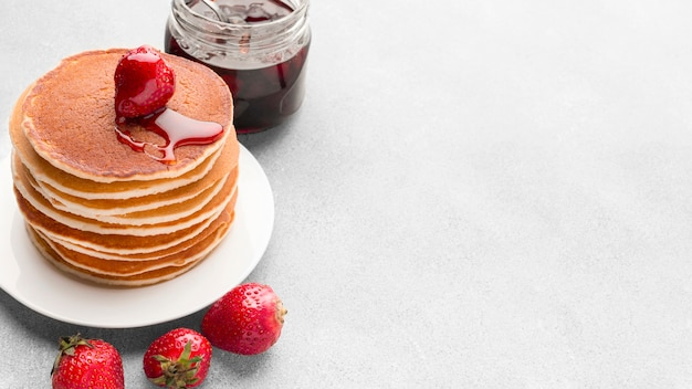High angle pancakes arrangement with jam Free Photo