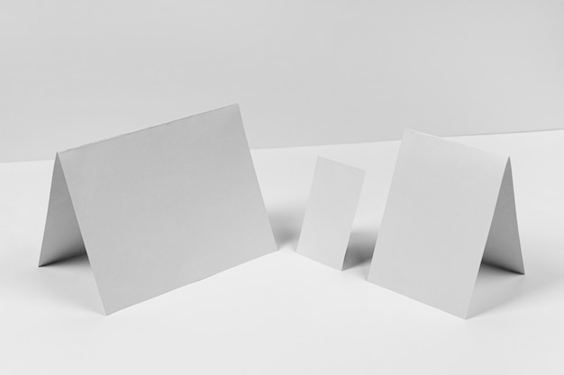 High angle paper pieces on white background Free Photo