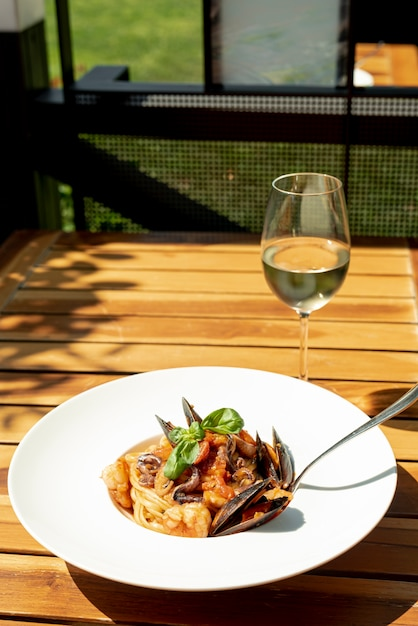 High Angle Of Pasta And Wine On Wooden Table Photo Free