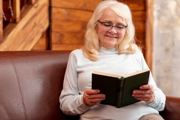 High angle senior female reading Free Photo