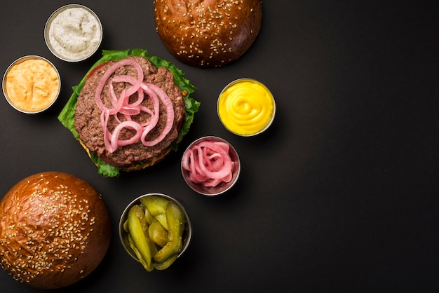 High angle set of tasty hamburgers with sauces Free Photo
