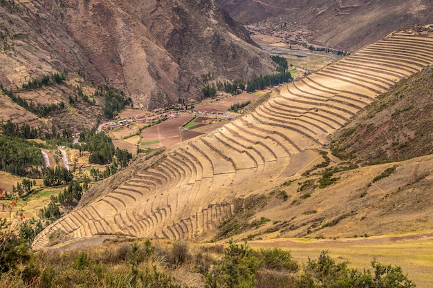 High angle shot of the beautiful fields and mountains captured in pisac, peru Free Photo