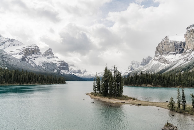 High angle shot of a clear frozen lake surrounded by a mountainous scenery Free Photo