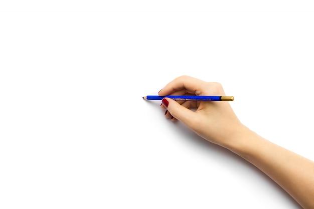 Высокий угол выстрела человека, рисование на белой бумаге с синим карандашом Бесплатные Фотографии