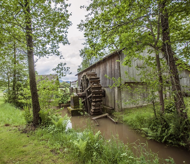 High angle shot of an old building a water mill in the countryside in slovenia Free Photo