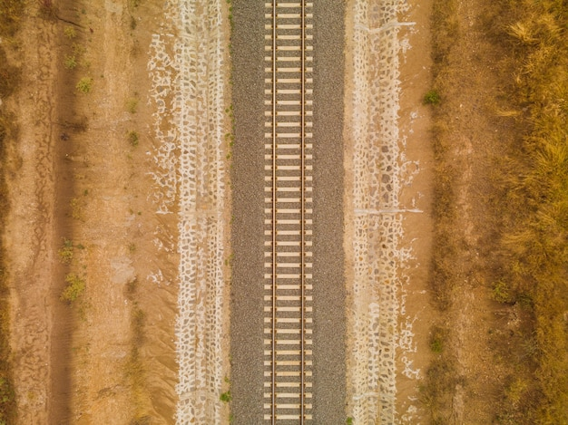 High angle shot of the railway in the middle of the desert captured in nairobi, kenya Free Photo