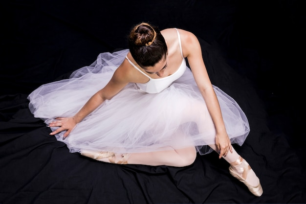 High angle sitting ballerina position Free Photo