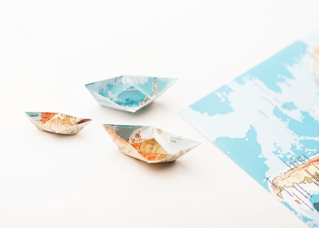 High angle small paper world map boats Free Photo