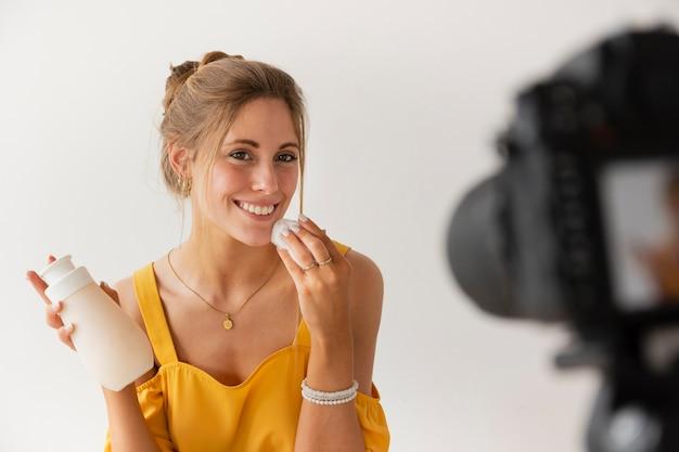 High angle smiley blogger filming Premium Photo