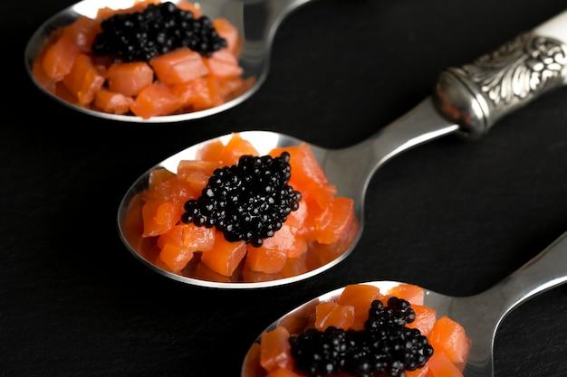 High angle spoons with black caviar Free Photo