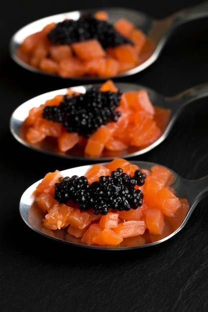 High angle spoons with caviar and fish Free Photo